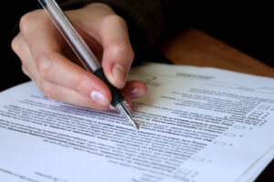 legal, law concept -  review and filling out legal contract forms.